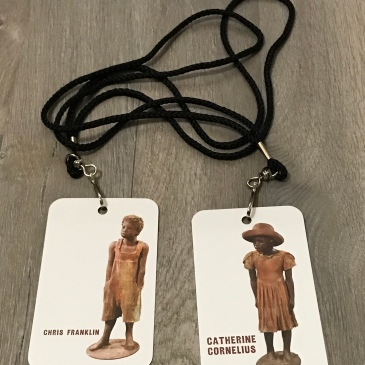 Photo of two Whitney Plantation tickets with lanyards.